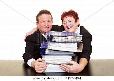 Business Team With Stack Of Files
