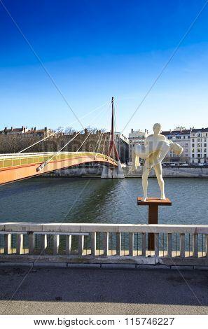 Statue And Bridge Along The Saone River At Lyon City, France
