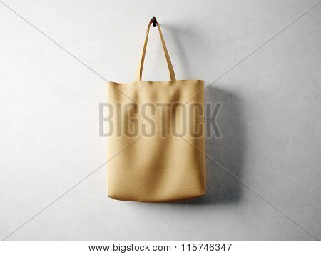 Cotton textile bag holding, neutral background. 3d render