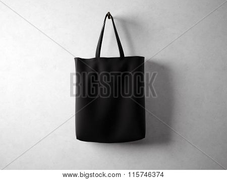 Cotton black textile bag holding, neutral background. 3d render