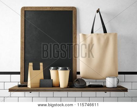 Black chalkboard on bookshelf with coffee set. 3d rendering