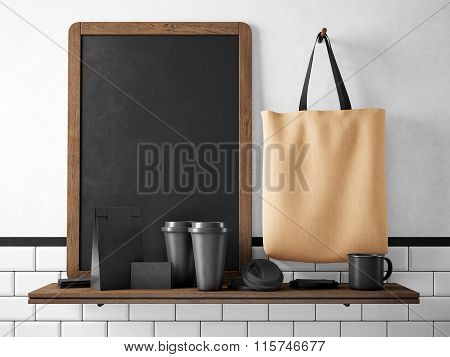 Black chalkboard on bookshelf with set of branding elements. 3d rendering