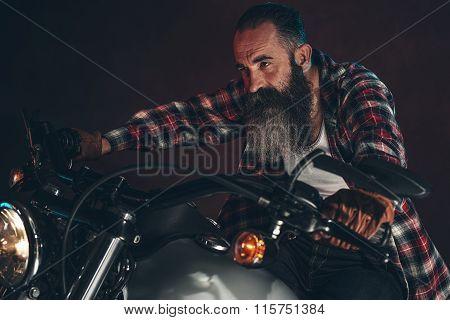 Casual Cool Long Beard Man On Motorcycle At Night.
