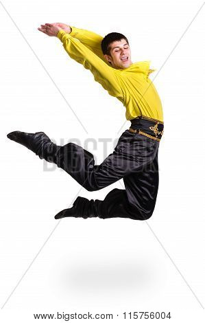 Jumping man wearing a toreador costume. Isolated on white in full length.
