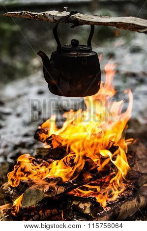 Coffee brewing on a campfire