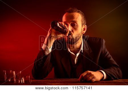Businessman Drinking a Beer