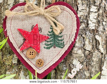 Embroidered Heart On Tree Bark
