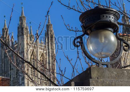 Street Lamp And Tree Branches With Canterbury Cathedral In The Background