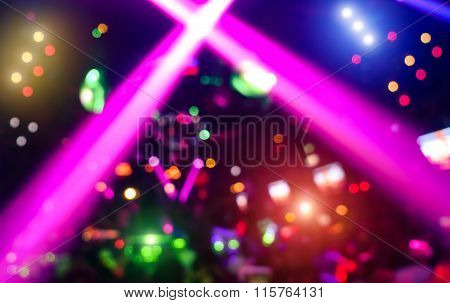 Abstract Background With Defocused Bokeh Of Laser Show In Modern Disco Party Night Club