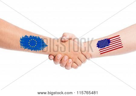 European Union And Usa Hands Shaking With Flags.