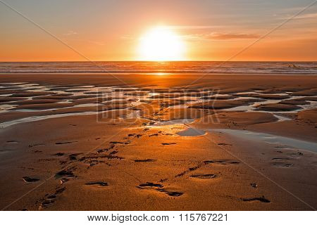 Vale Figueiras beach in Portugal at sunset