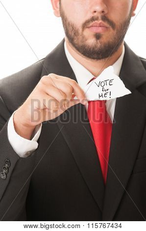 Politician Holding A Piece Of Paper Saying Vote For Me!.