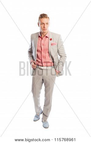 Man Wearing Grey Suit, Holding Hand In The Pants Pocket.
