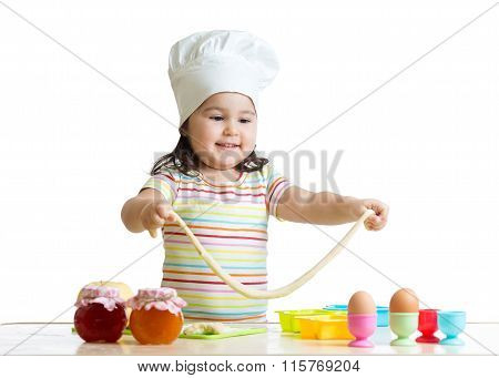 Little chef playing with dough
