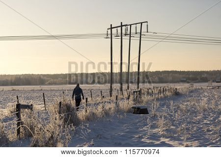 Man Walking In Winter Field