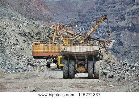 Excavator Loading Iron Ore