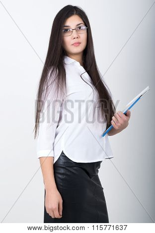 A young pretty slim asian woman in a white blouse, black leather skirt and glasses holding a folder