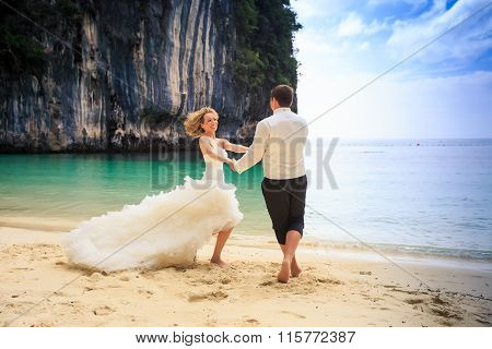 Groom Blonde Bride In Fluffy Dress Join Hands Swing On Beach