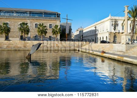 CARTAGENA, SPAIN - DECEMBER 26: A view of the port of Cartagena, Spain, on December 26, 2015 and the Whale Tail sculpture, designed by Fernando Saenz de Elorrieta, emerging of the seawater