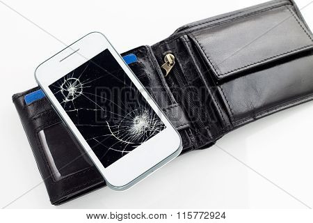 Smartphone with broken glass and black leather wallet.