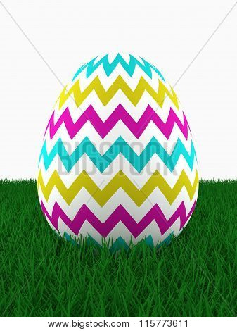 Easter Colored Egg Lying On Grass