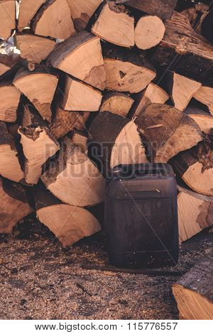 Firewood Pile And Plastic Oil Canister