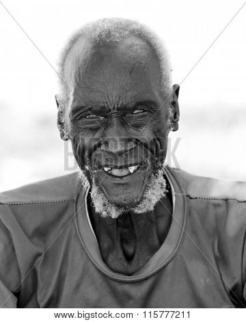 PANWELL, SOUTH SUDAN-DECEMBER 4, 2010: Portrait of an unidentified man of the Dinka tribe in rural South Sudan.