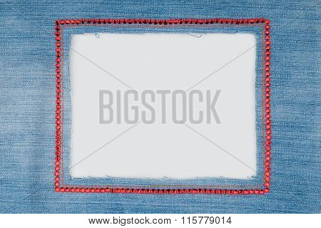 Frame Is Made From Denim With Red Rhinestones  On A White Background.