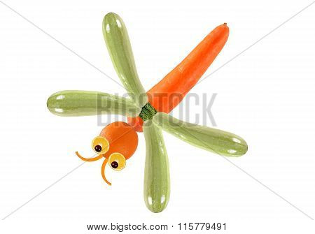 Creative Food Concept. Funny Little Dragonfly Made Of Fruits And Vegetables
