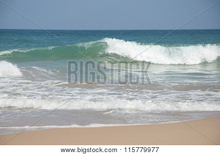 Waves breaking near the shore at Tangalle, Sri Lanka