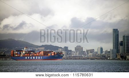 HYUNDAI Cargo Ship LONG BEACH waiting in the San Francisco Bay with city in the background