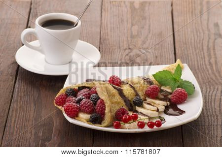 Crepes With Berries. Crepe with Strawberry Raspberry Blueberry and Chocolate topping. Pancake