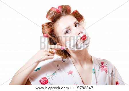young pinup housewife woman wearing curlers and shaving face