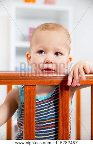 Baby Boy Standing In The Crib