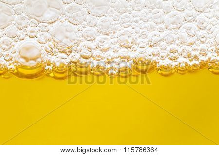 Close up border between the beer and foam