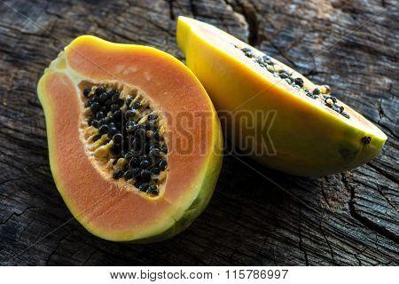 Papaya on wooden background