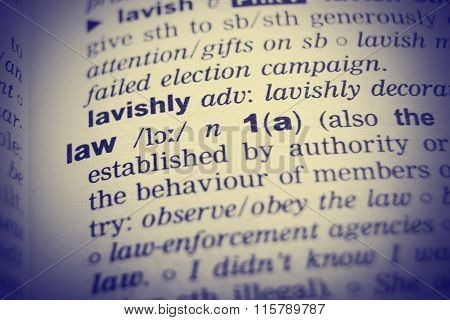 Dictionary definition of the word Law with vignetting effect.