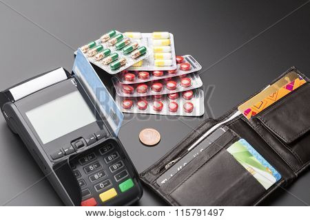 POS terminal and heap of pill blister packs