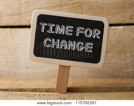 Time for change wooden sign on wood background