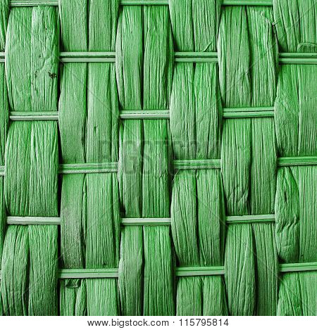 Imaginative Green Woven Reed / Wood Abstract Background Texture.