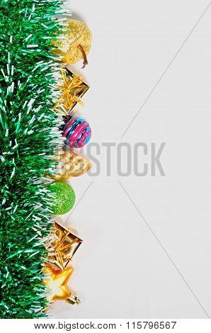 Glass And Plastic Christmas Toys And Green Tinsel Bright Garland Isolated On White Background.