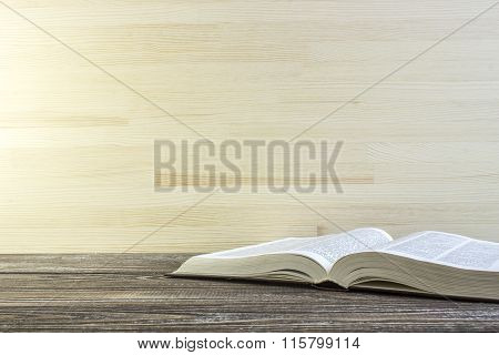 Open Book On A Corner Of Wooden Table