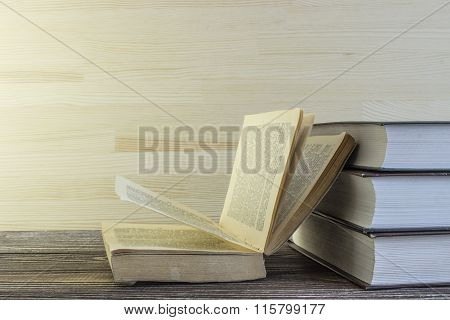 Books On A Corner Of Wooden Table