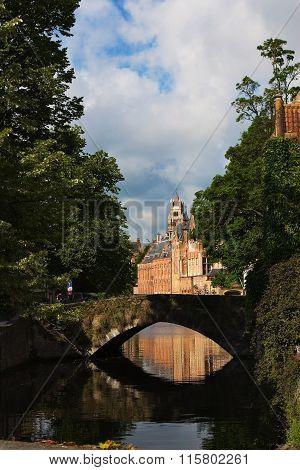 Medieval Bridge Over Canal In Brugge, Belgium