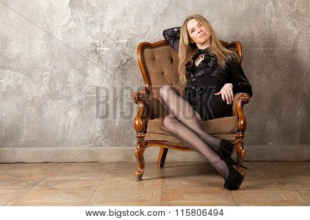 Woman Sitting In Armchair