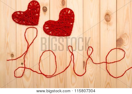 Valentines Day. Symbols Of Love -  Two Knitted Hearts