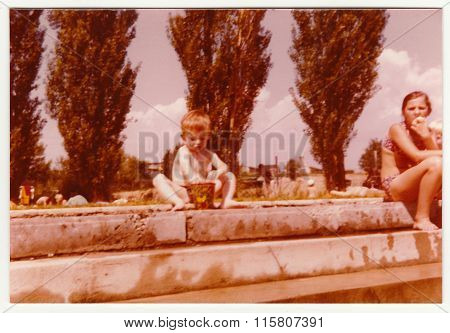 Vintage photo shows a small boy on a public swimming pool, circa 1974.