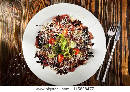 Italian Starter - Beef Carpaccio Dressing with Parmesan Cheese and Tomato