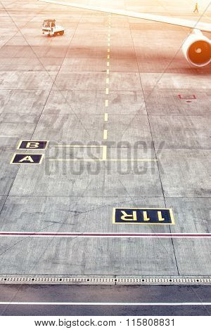 Airplane Parking Markings With Yellow Taxi Line On Airfield
