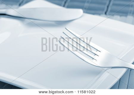 Fork And A Knife Laying On A Plate